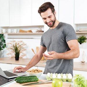 storyblocks-man-with-laptop-preparing-food-at-the-kitchen-at-home_saeat6s6qb-20200820163028